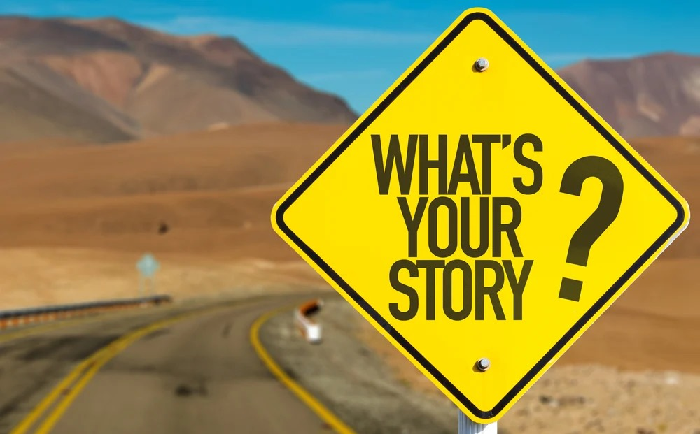 Whats-Your-Story_sign-on-desert-road